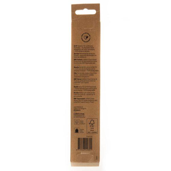 Produktfoto der Rückseite der Verpackung einer Holzzahnbürste